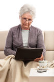 Senior woman notebook tablet keyboard dock Royalty Free Stock Images