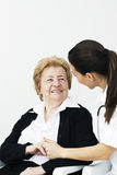Senior woman with nurse Stock Photography