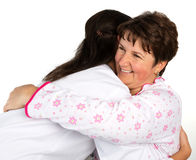 A senior woman and nurse hugging Stock Photo