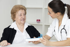 Senior woman with nurse Stock Images