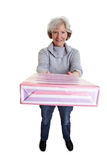 Senior woman offering present Royalty Free Stock Images