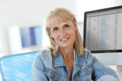 Senior woman at office working on computer Royalty Free Stock Photo