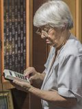 Senior woman with old calculator Stock Images