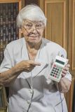 Senior woman with old calculator Royalty Free Stock Image