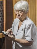 Senior woman with old calculator Royalty Free Stock Photo