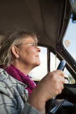 Senior woman in oldtimer car Royalty Free Stock Photo