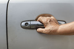 Senior woman open a car door Royalty Free Stock Image