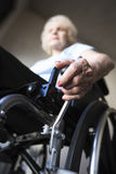 Senior Woman Operating Wheelchair Royalty Free Stock Image