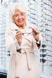 Senior woman in optical shop Royalty Free Stock Image