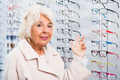 Senior woman in optician store Royalty Free Stock Images