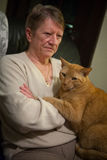 Senior Woman and Orange Cat Stock Photo