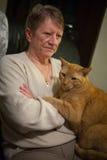 Senior Woman and Orange Cat Stock Photo