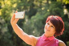 Senior woman outdoor selfie Royalty Free Stock Photos