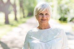 Senior woman outdoors. Happy senior woman smiling outdoors Stock Photos