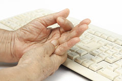 Senior woman painful finger cause use of keyboard Royalty Free Stock Images