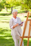 Senior woman painting Royalty Free Stock Images