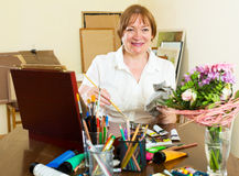 Senior woman painting picture Stock Images