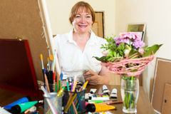 Senior woman painting picture Royalty Free Stock Photo
