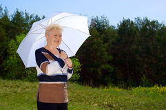 Senior woman with parasol Royalty Free Stock Image
