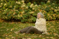 Senior woman in the park Stock Photos