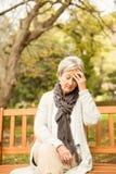 Senior woman in the park Royalty Free Stock Photos