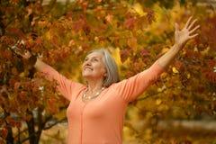 Senior woman in park Stock Photos