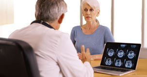 Senior woman patient listening to doctor talking Royalty Free Stock Photography