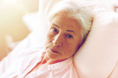 Senior woman patient lying in bed at hospital ward Royalty Free Stock Image