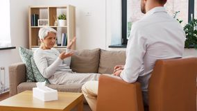 Senior woman patient talking to man psychologist stock video footage