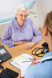 Senior woman patient with UK nurse Royalty Free Stock Image