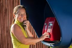 Senior woman  on  pay phone Stock Images