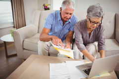 Senior woman paying bills online on laptop Stock Photography