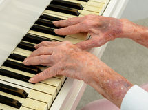 Senior woman Pays Piano Stock Image