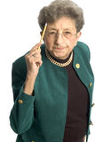 Senior woman with pencil. Attractive senior woman business executive with pencil royalty free stock photo