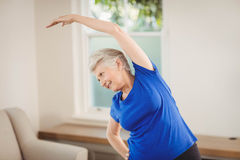 Senior woman performing stretching exercise Stock Photography