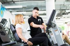 Senior woman with personal trainer. Senior women with personal trainer at fitness centre Royalty Free Stock Images
