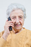 Senior woman on phone Royalty Free Stock Photos