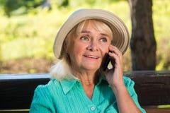 Senior woman on the phone. Stock Photos