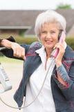 Senior woman at phone Royalty Free Stock Image