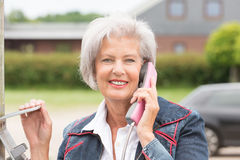 Senior woman at phone Royalty Free Stock Photo