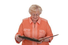 Senior woman with photo album Stock Images