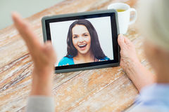 Senior woman with photo on tablet pc at home Royalty Free Stock Photo
