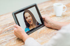 Senior woman with photo on tablet pc at home Royalty Free Stock Image