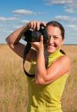 Senior woman with photocamera Royalty Free Stock Photo