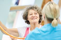Senior woman at the physiotherapy royalty free stock photography