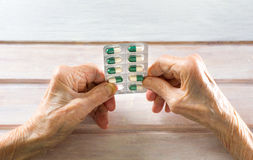 Senior woman picking her today pills Royalty Free Stock Photography