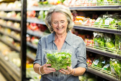Senior woman picking out some vegetables. In supermarket Royalty Free Stock Images