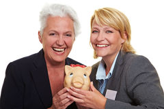 Senior woman with piggy bank Royalty Free Stock Image