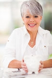 Senior woman piggybank Royalty Free Stock Photography
