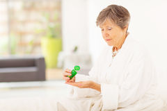 Senior woman pills Royalty Free Stock Images
